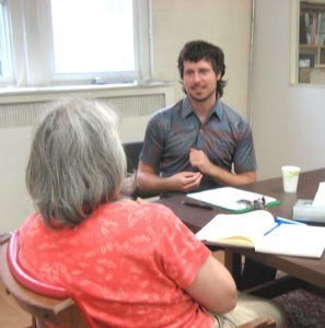 A photo of Jade Barbee offering a personalized EFT session with a client.